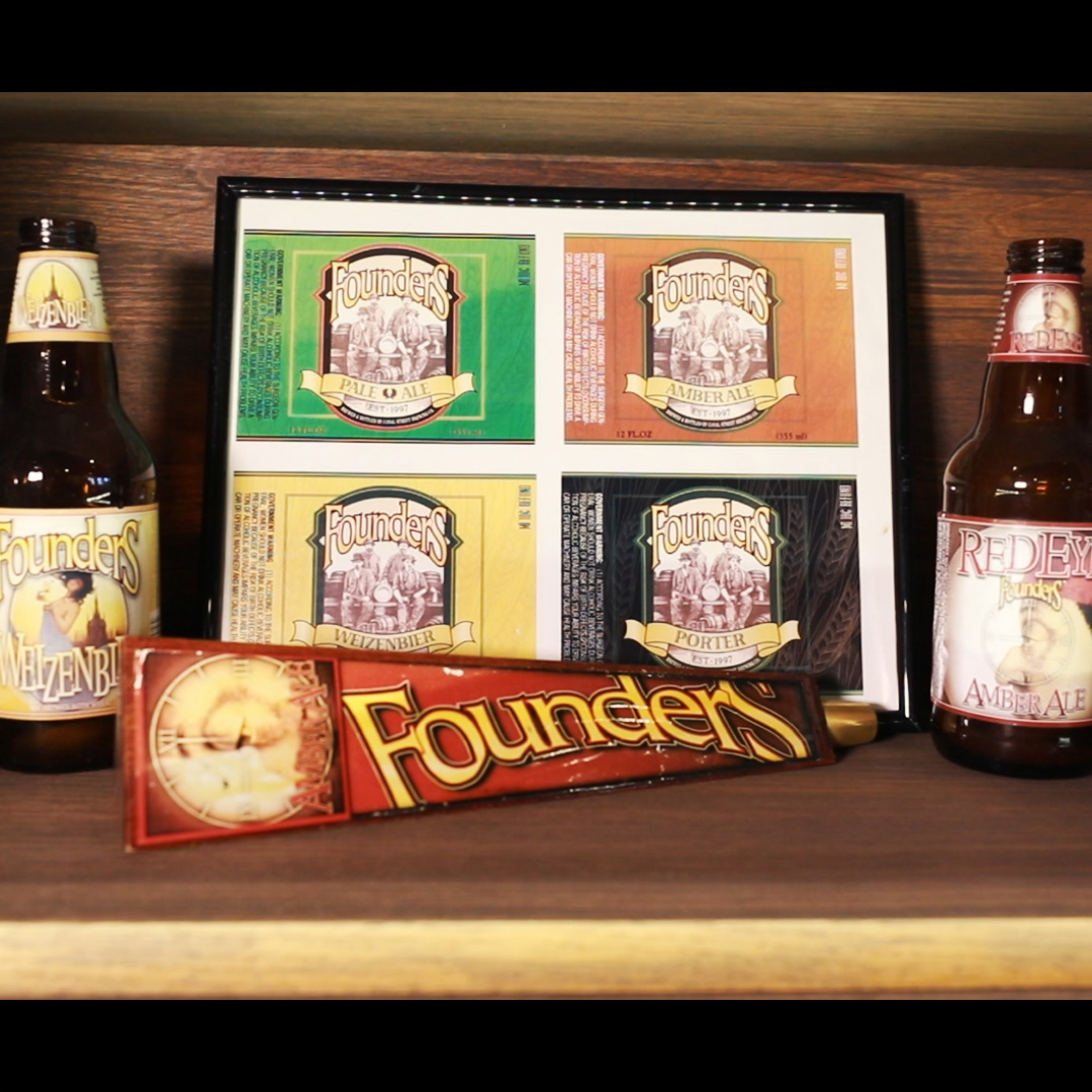 Founders beer bottles with an image of Founder's beer labels on a shelf