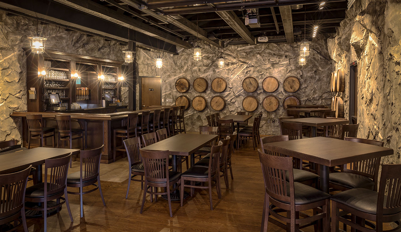View of the Barrel Room showing the bar and tables and chairs