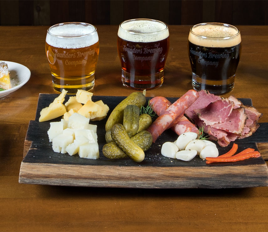 Glasses of beer and charcuterie board