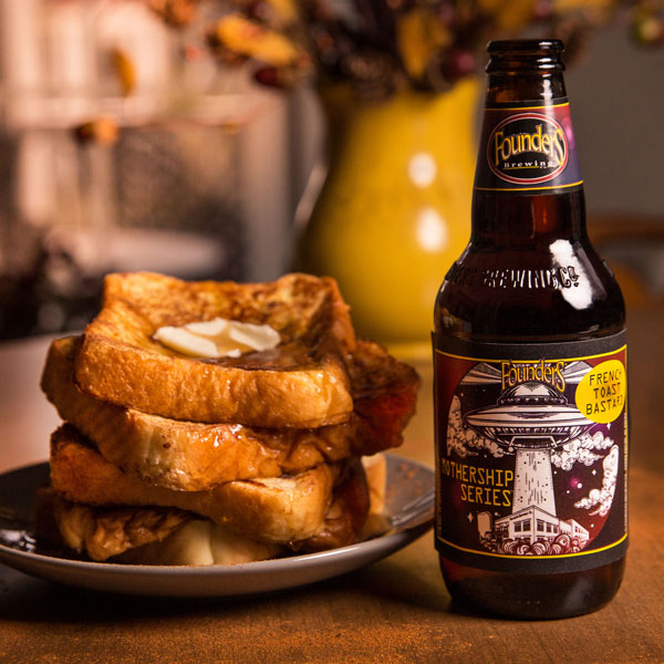 Bottle of Founders Mothership Series French Toast Bastard next to plate of french toast