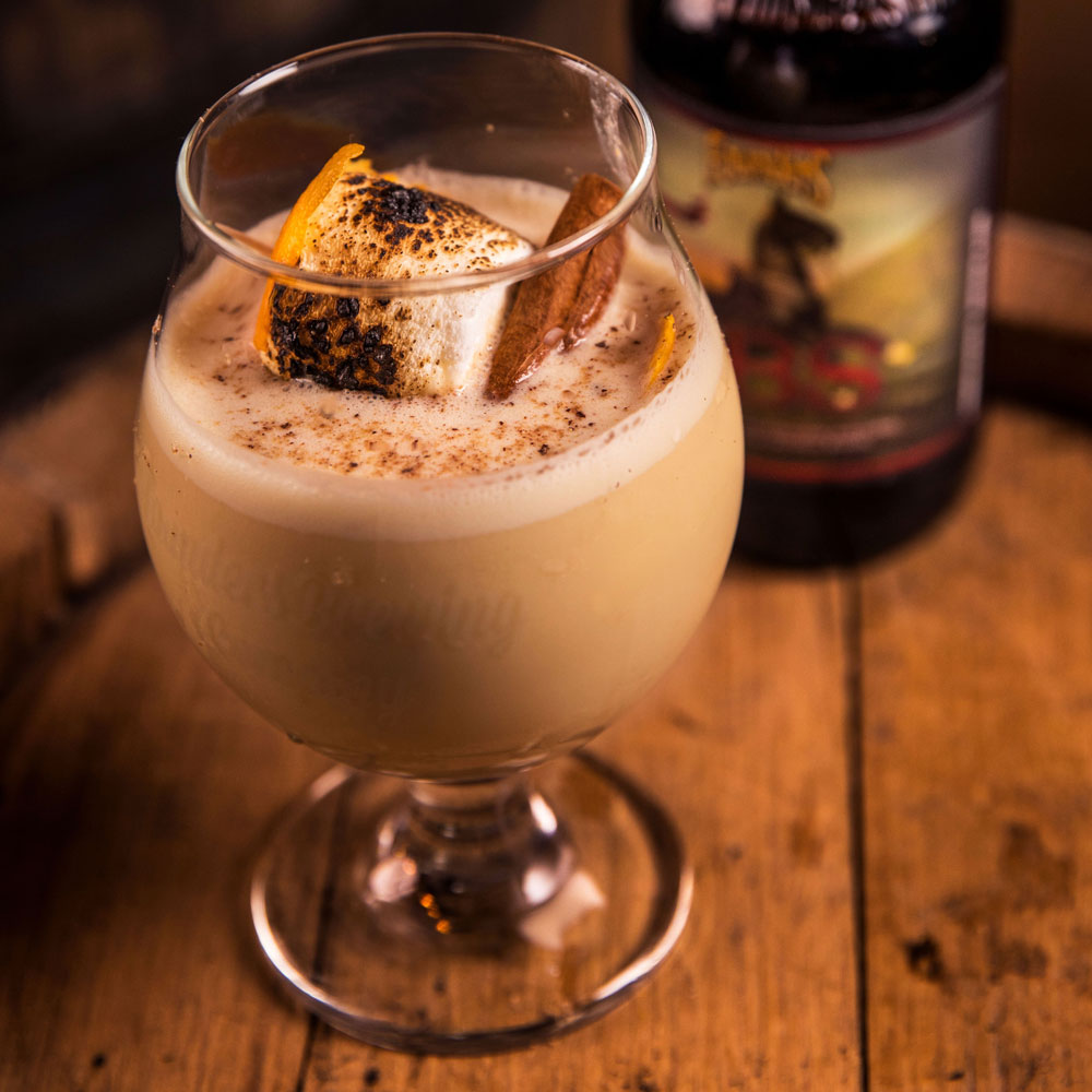 Beer glass filled with Founders CBS egg nog