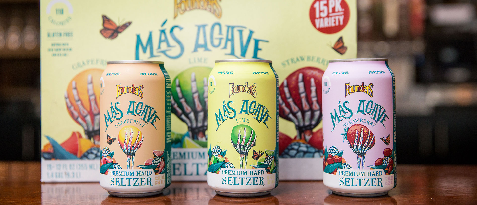 Mas Agave Premium Hard Seltzer cans in front of a 15-pack