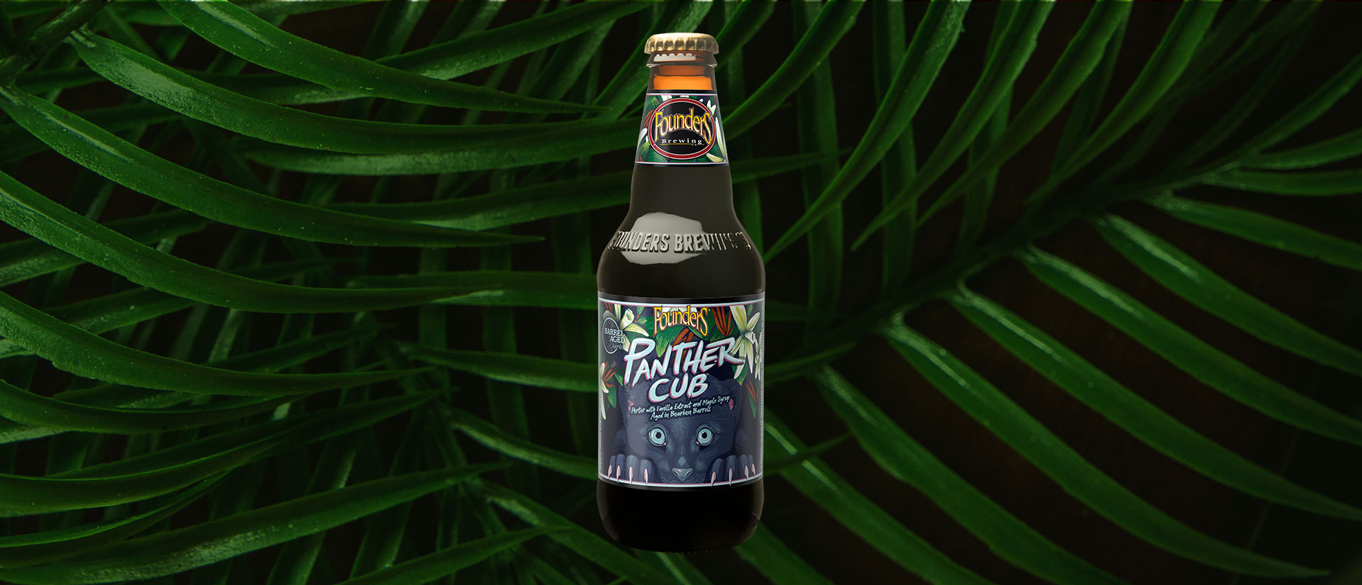 slider image with Panther Cub bottle on top of palm fronds